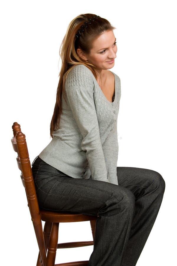 stolsflickan sitter trä royaltyfri fotografi