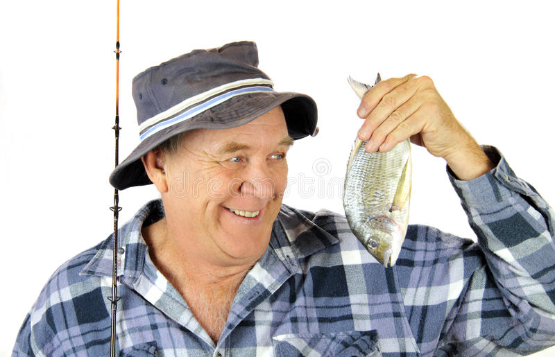stolt fiskare royaltyfri bild