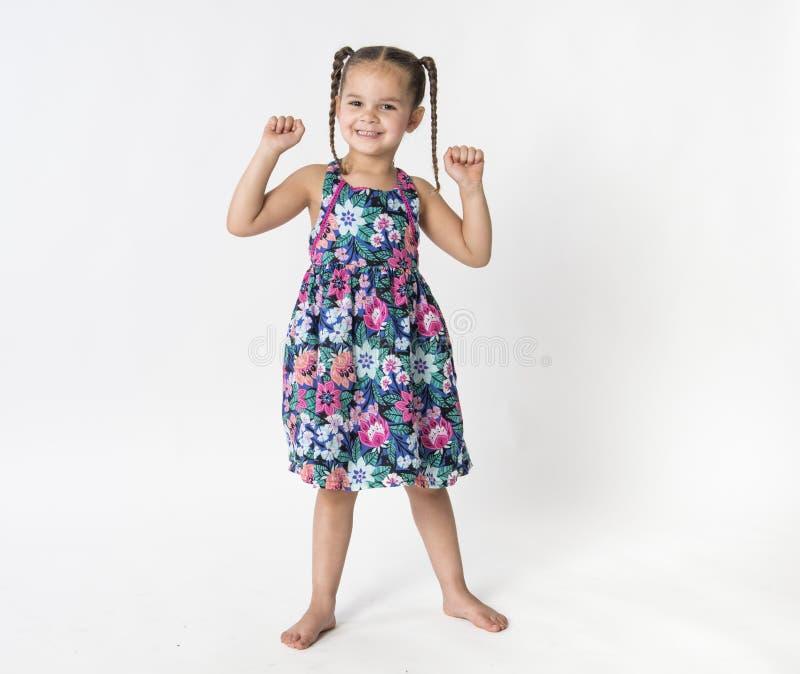Stolt, lycklig upphetsad liten flicka royaltyfria bilder