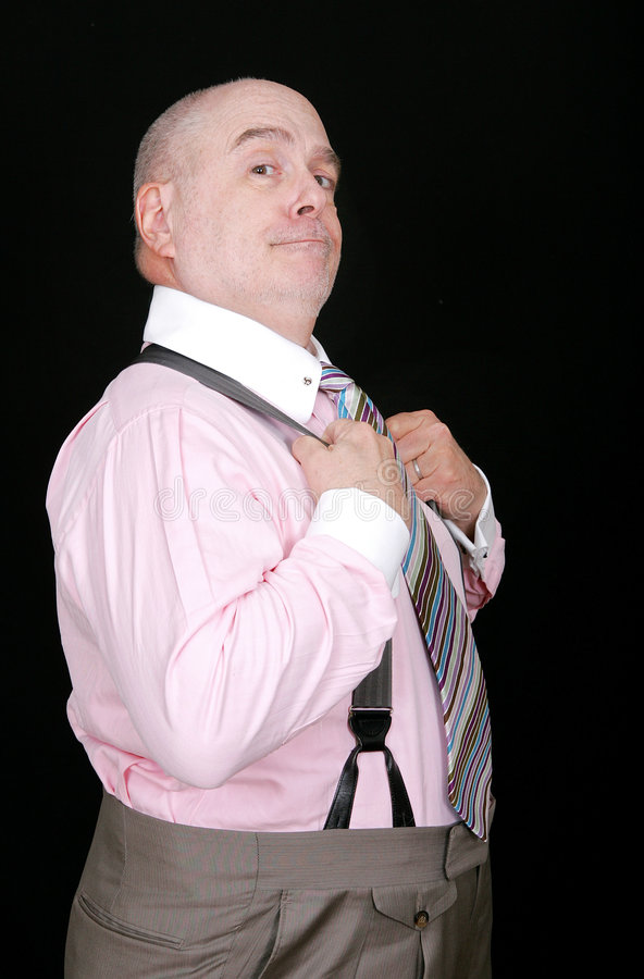 stolt suspenders för holdingman royaltyfria foton