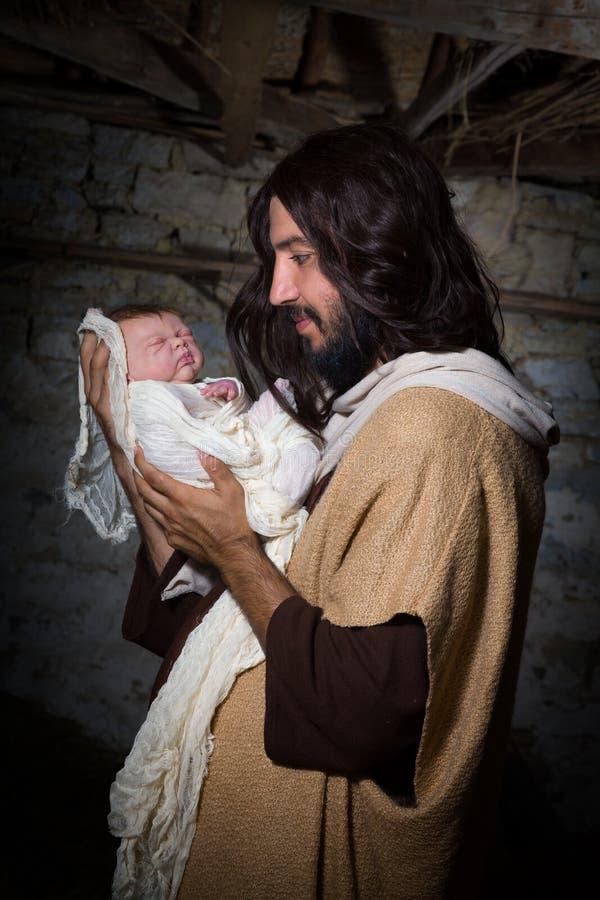Stolta Joseph med behandla som ett barn Jesus arkivbilder