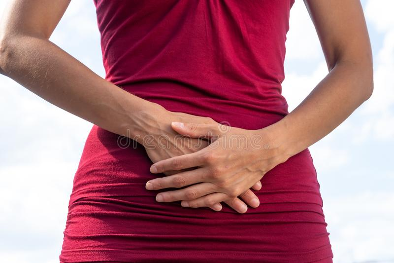 Menstrual pain. Stomach ache. Woman with menstrual or abdominal pain stock images