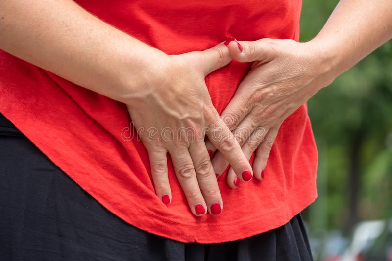Abdominal pain. Stomach ache. Woman with menstrual pain. Selective focus stock image