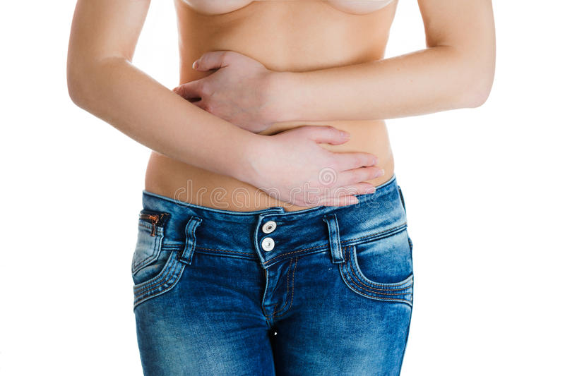 Stomach or menstrual pain. Woman with pains in abdomen. Female belly and hands close up. Stomach pain or menstrual pain. Woman with pains in abdomen royalty free stock photos