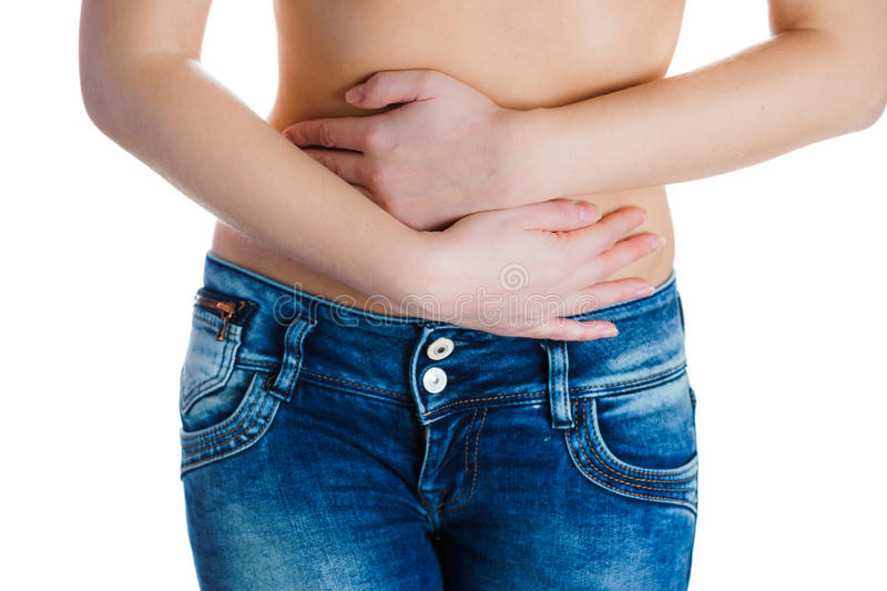 Stomach or menstrual pain. Woman with pains in abdomen. Female belly and hands close up. Stomach pain or menstrual pain. Woman with pains in abdomen stock image