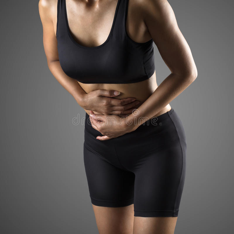 Stomach pain. Closeup stomach pain or menstrual pain woman with pains in abdomen female belly and hands royalty free stock image