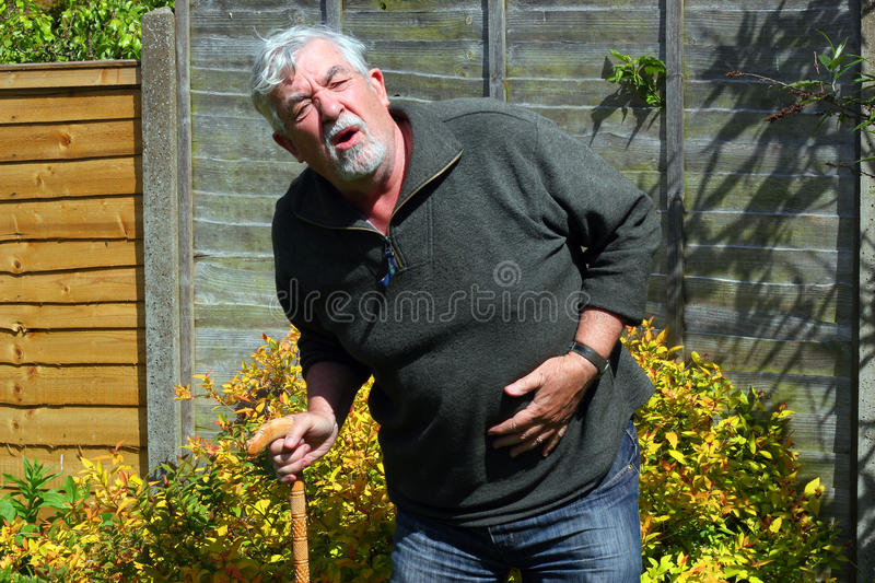 Stomach pain. stock images