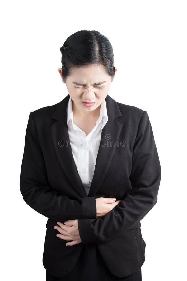 Stomachache в женщине изолированной на белой предпосылке Путь клиппирования на белой предпосылке стоковое фото