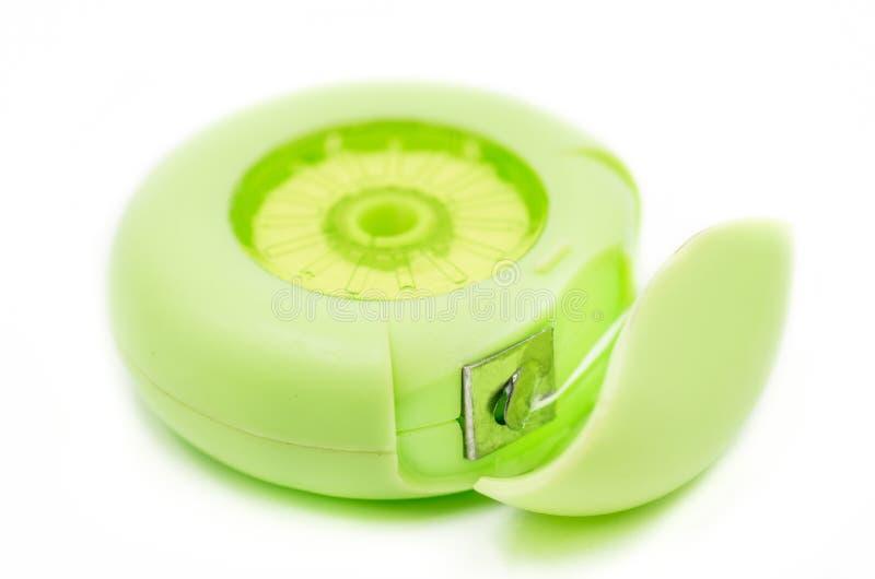 Stomatologiczny floss w zielonym round pudełku zdjęcie stock