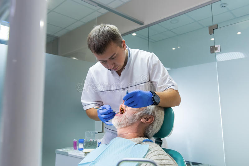 Stomatologist with senior patient. Person at the dentist office stock image
