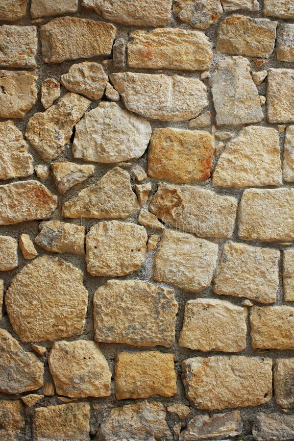 Stone. Laying of natural stone - vertical wall stock images
