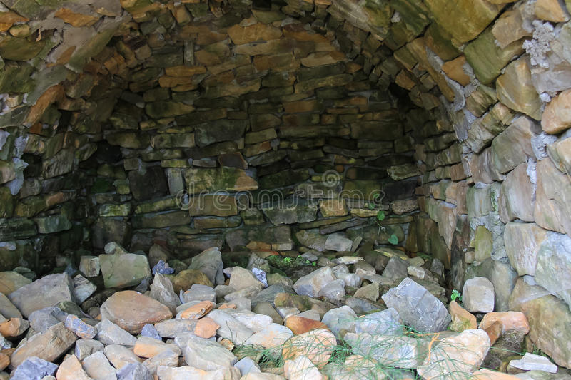 Stone alcove. And scattering of stones royalty free stock photos