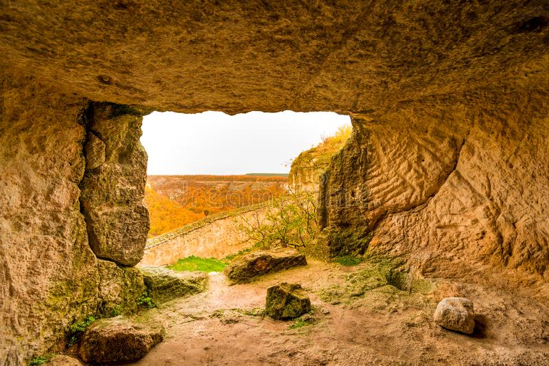 Stone ancient rooms of the cave city of Chufut-Kale, Bakhchisarai Crimea. Autumn shots royalty free stock images
