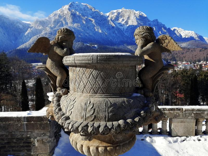 Medieval Stone Angels Looking At Eachother On The Bucegi Mountains Snowy Backdrop stock image