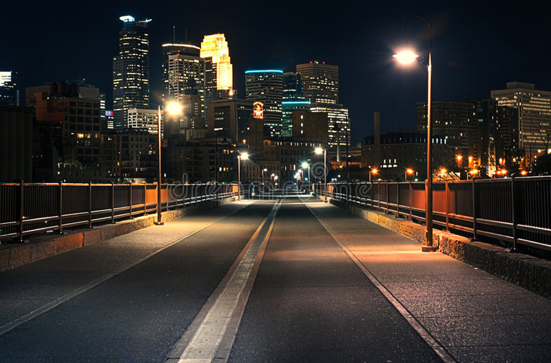 Stone Arch Bridge at Night. Downtown Minneapolis in background royalty free stock images
