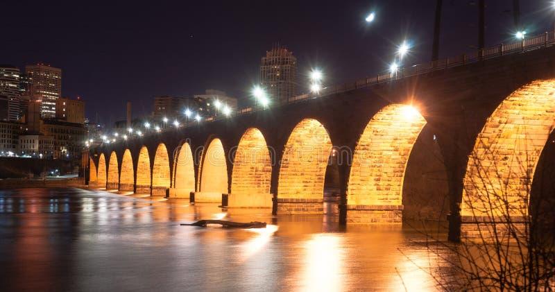 Stone Arch Bridge St Paul Minnesota Mississippi River Night. Great lighting makes a dramitic scene on the Mississippi River in St. Paul stock image