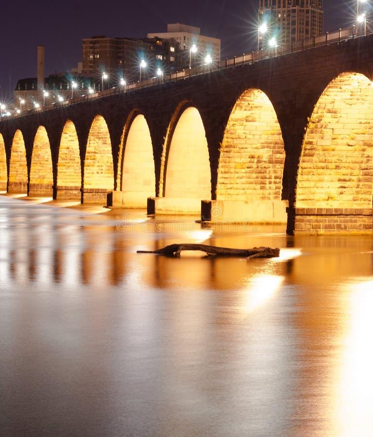 Stone Arch Bridge St Paul Minnesota Mississippi River Night. Great lighting makes a dramitic scene on the Mississippi River in St. Paul stock images