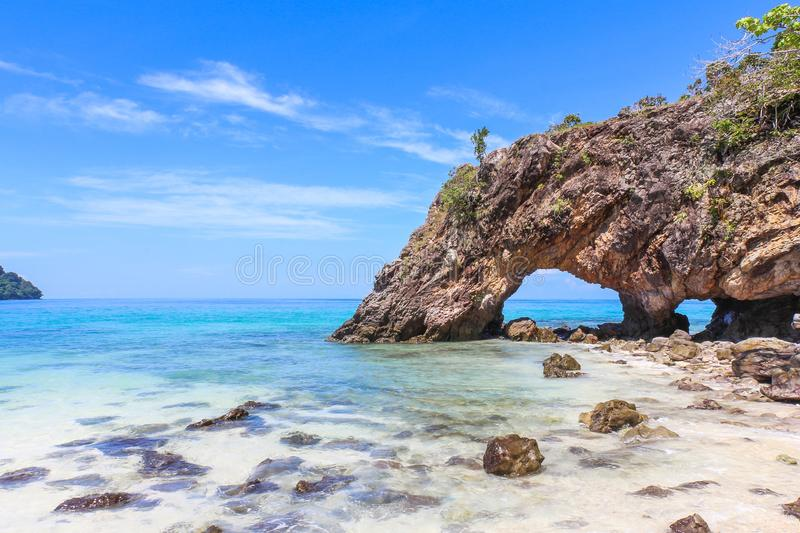 The Stone arch at Khai Island, Tarutao National Park, Satun Province, Thailand. Stone arch at Khai Island, Tarutao National Park, Satun Province, Thailand. This royalty free stock image