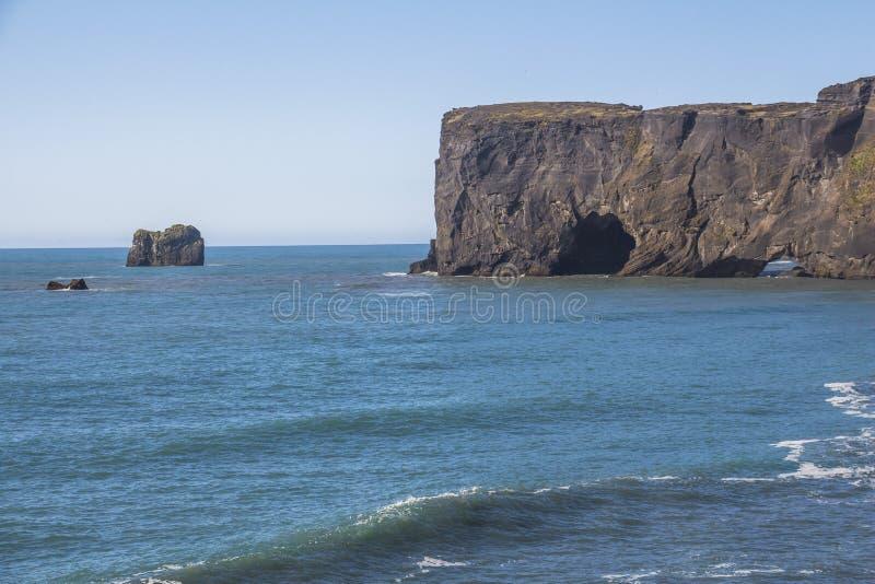 Stone arch view near Kirkjufjara beach, Iceland royalty free stock photo