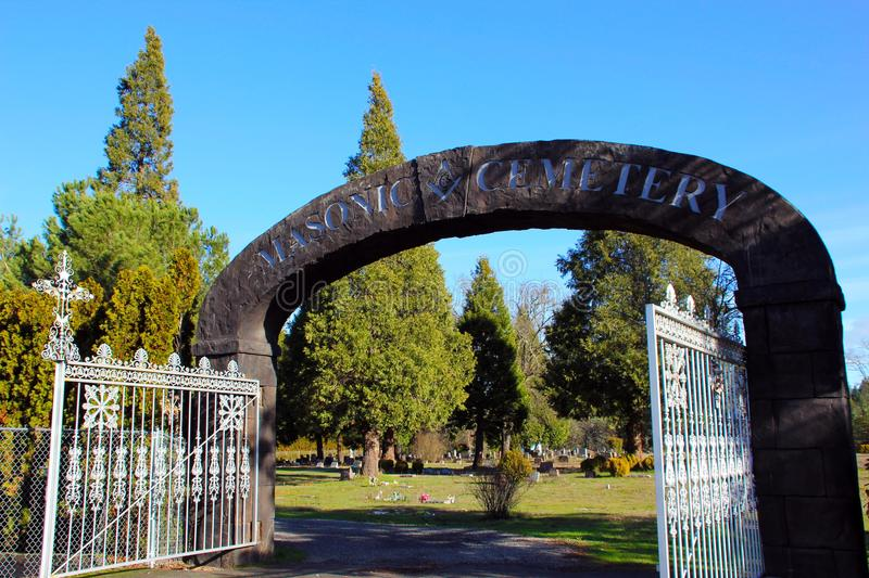 Stone archway at entrance to Masonic Cemetery, Canyonville, Oregon royalty free stock images