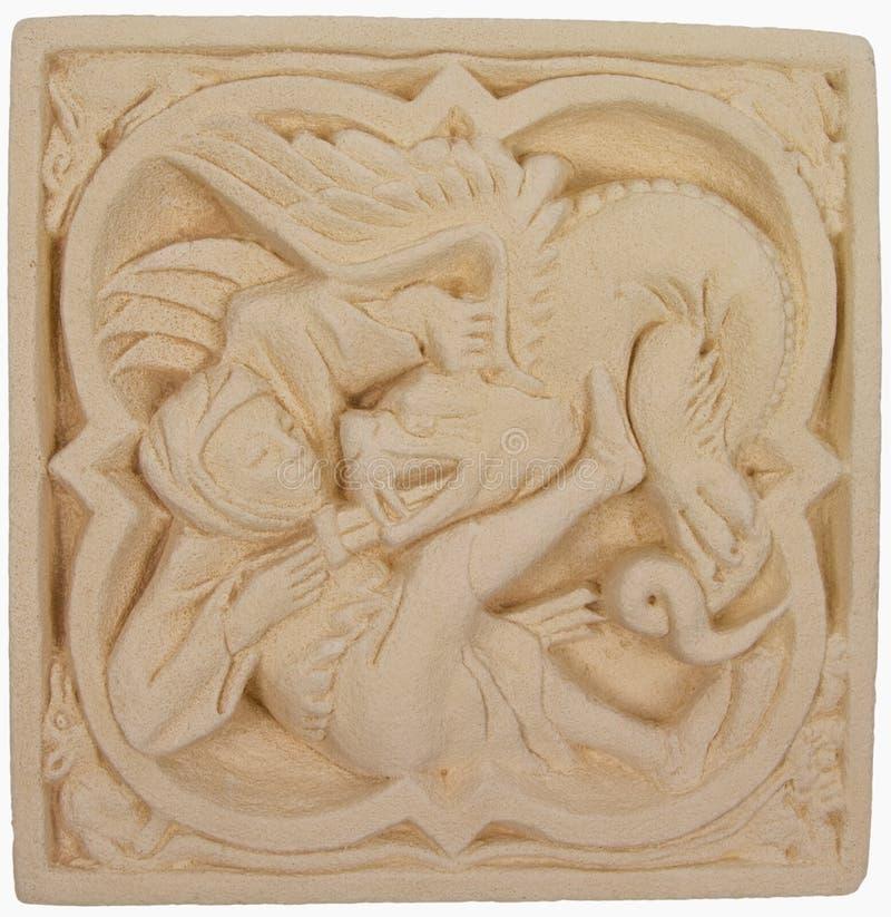 Stone artifact of Saint George slaying the dragon royalty free stock photo