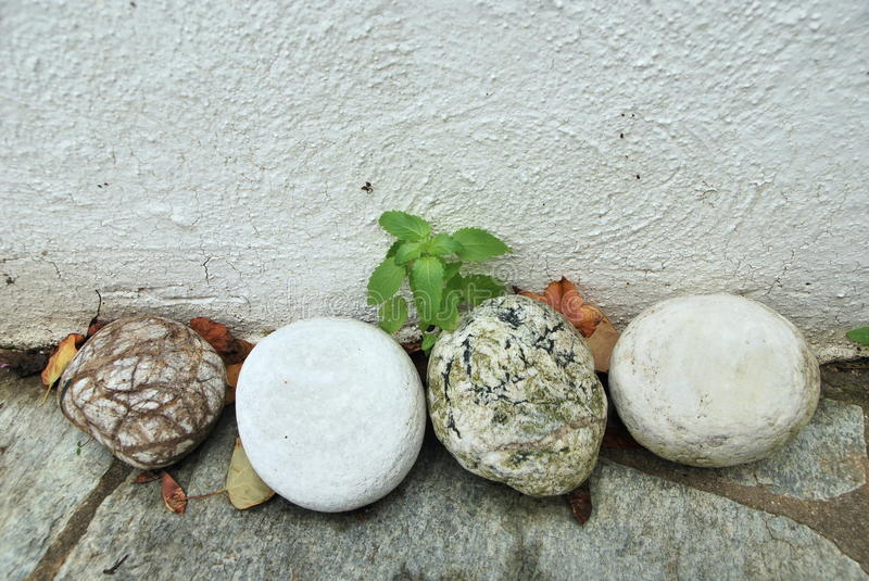 Haphazard collection of stones against wall royalty free stock photography