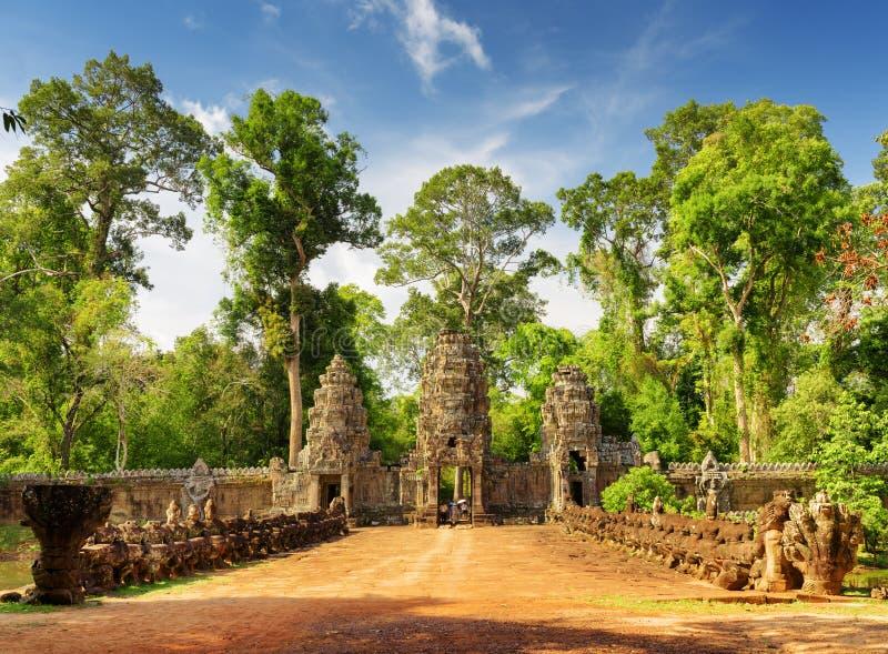 Stone Asuras on bridge leading to Preah Khan temple in Angkor. Stone Asuras on bridge leading to ancient Preah Khan temple in Angkor, Siem Reap, Cambodia stock photo