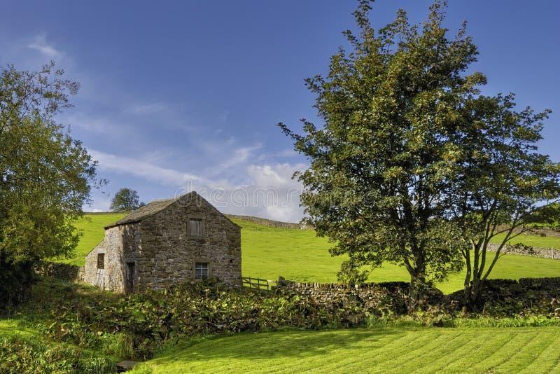 Stone barn in countryside stock photo