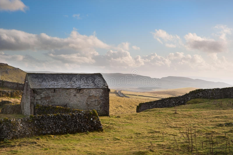 Download Stone Barn And Rock Walls In Autumn Sunset Landscape Stock Photo - Image: 28200400