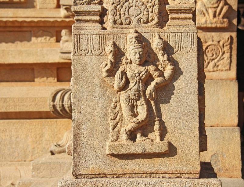 Stone bas-reliefs on the walls in Temples Hampi. Carving stone a royalty free stock photo