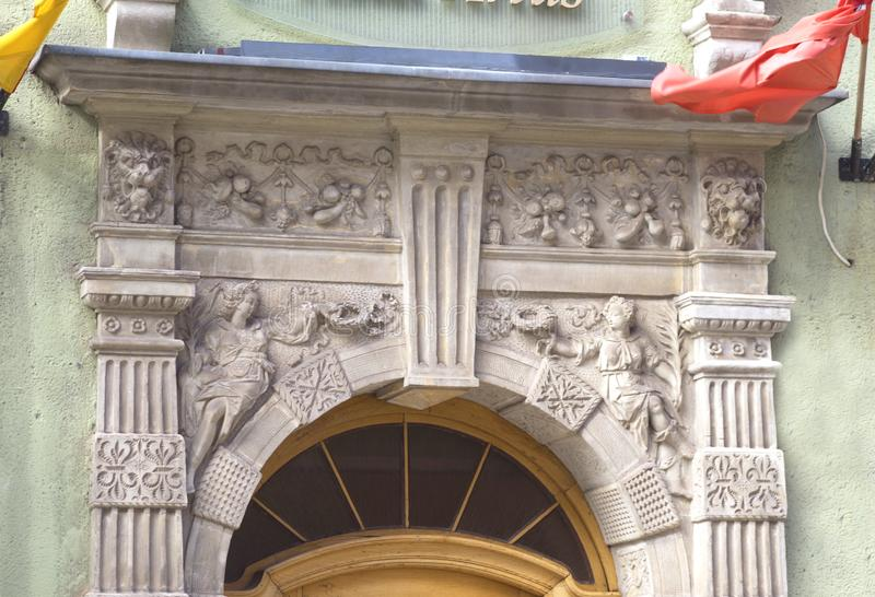 Stone bas-reliefs of Gdansk. Gdansk is an old Polish and German cultural center with incredibly beautiful architecture. Ancient stone carvings of bas-relief on royalty free stock image