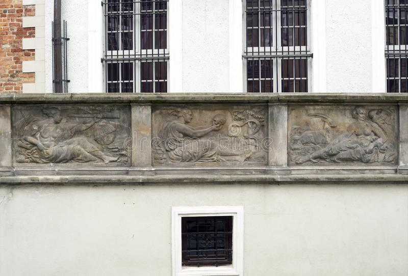 Stone bas-reliefs of Gdansk. Gdansk is an old Polish and German cultural center with incredibly beautiful architecture. Ancient stone carvings of bas-relief on stock photography