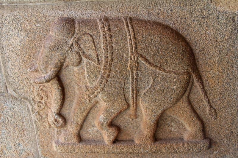 Stone bas-reliefs on the walls around the Vittala Temple in Hampi, Karnataka, India. royalty free stock photos