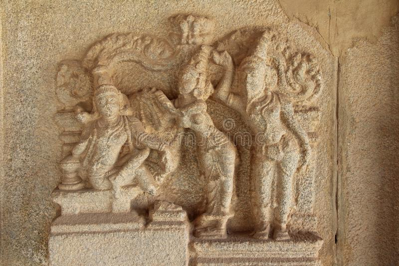 Stone bas-reliefs on the walls around the Vittala Temple in Hampi, Karnataka, India. royalty free stock image