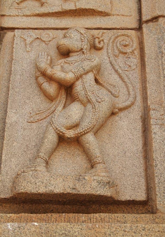 Stone bas-reliefs on the walls around the Vittala Temple in Hampi, Karnataka, India. stock photography