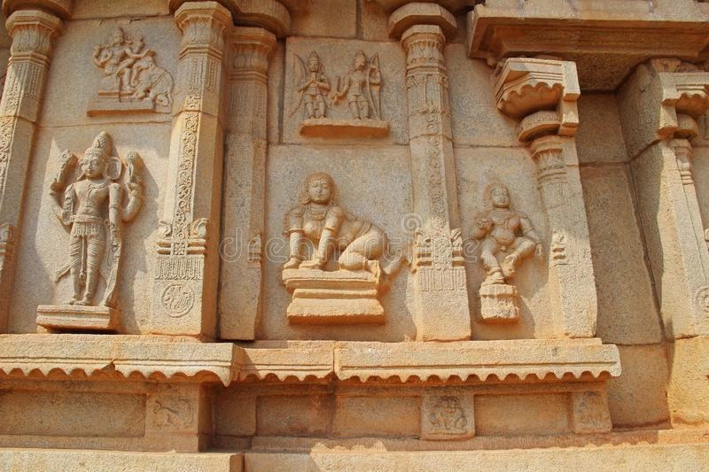 Stone bas-reliefs on the walls around the Vittala Temple in Hampi, Karnataka, India. royalty free stock images