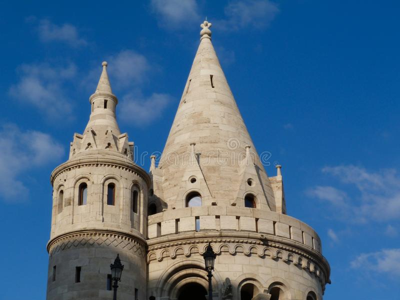 Stone bastion turret exterior detail in Budapest, Hungary. Architectural stone turret detail of Fisherman`s Bastion in Budapest, a popular landmark. stone towers royalty free stock photography
