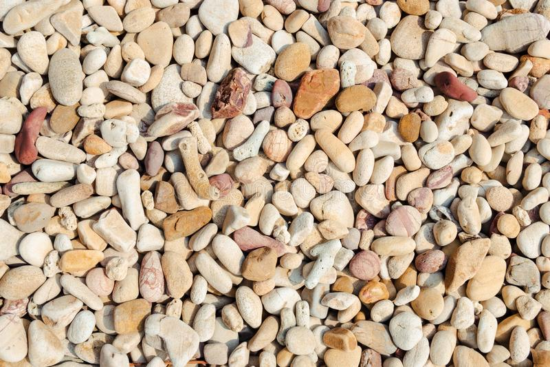 Stone beach background. Abstractbackdropbackgroundbeachcloseupdetailgravelgraygreygroundmaterialnatureoutdoorpatternrockroundseashapesmallsmoothstonestone royalty free stock photos