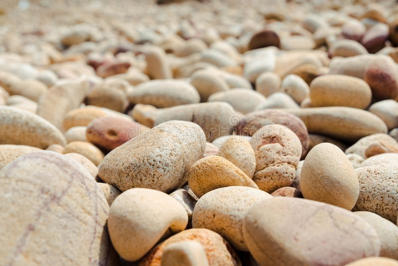 Stone beach background. Abstractbackdropbackgroundbeachcloseupdetailgravelgraygreygroundmaterialnatureoutdoorpatternrockroundseashapesmallsmoothstonestone stock images