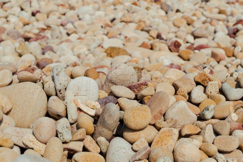 Stone beach background. Abstractbackdropbackgroundbeachcloseupdetailgravelgraygreygroundmaterialnatureoutdoorpatternrockroundseashapesmallsmoothstonestone stock photography