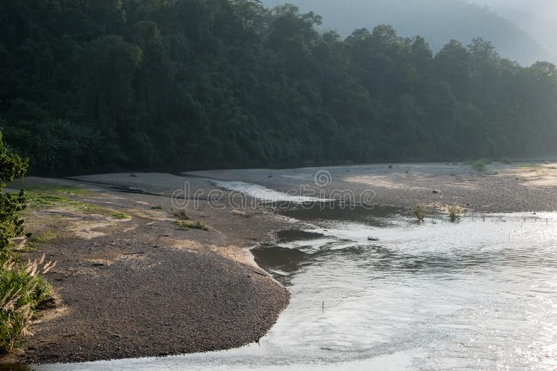 Stone beach on the bank of the river royalty free stock images