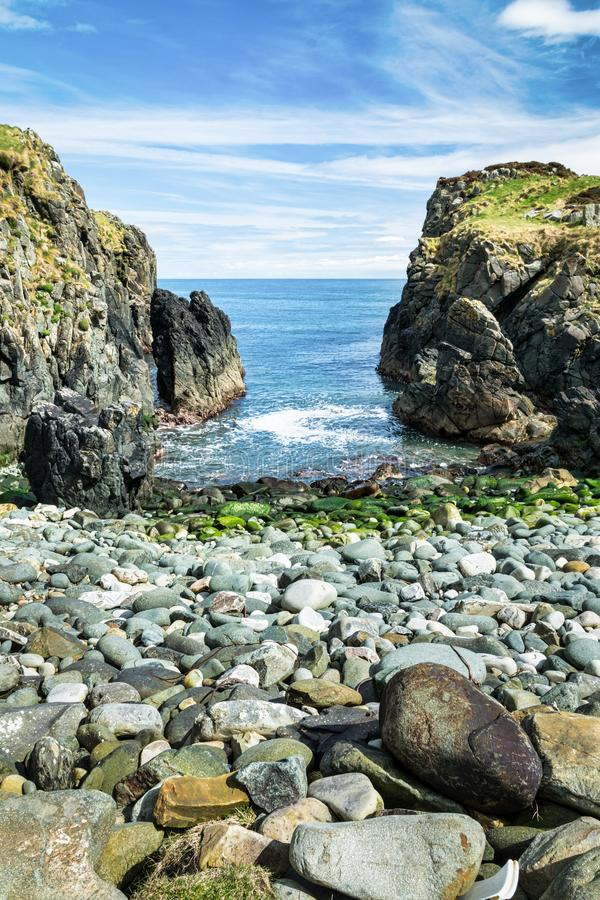 Stone Beach in Culdaf Ireland. Stone beach surounded by rocks. This photograph was taken near Culdaf pier in Donegal Ireland stock photography