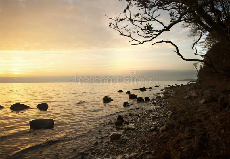 Stone beach sunset meditation tranquillity royalty free stock images