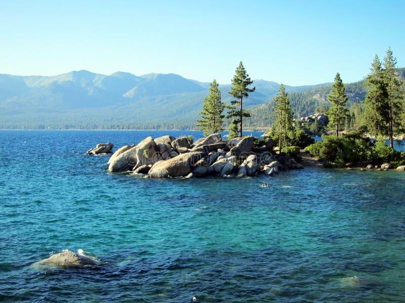 Stone beach, turquoise water at Lake Tahoe, Nevada royalty free stock image