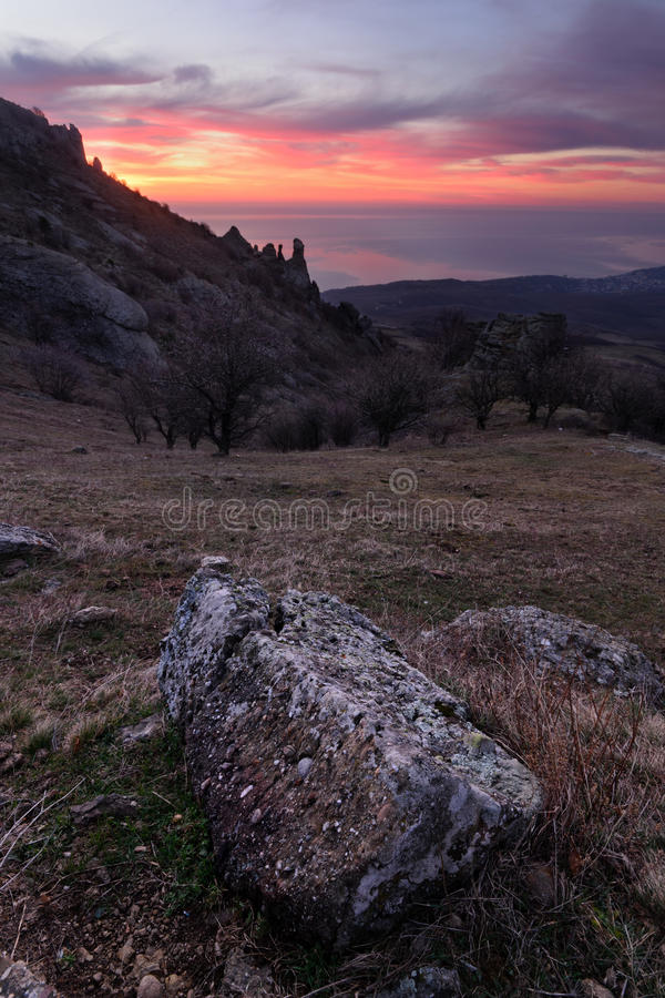 Stone. Beautiful view of sunny meadow at dawn, Demerji, Crimea royalty free stock images