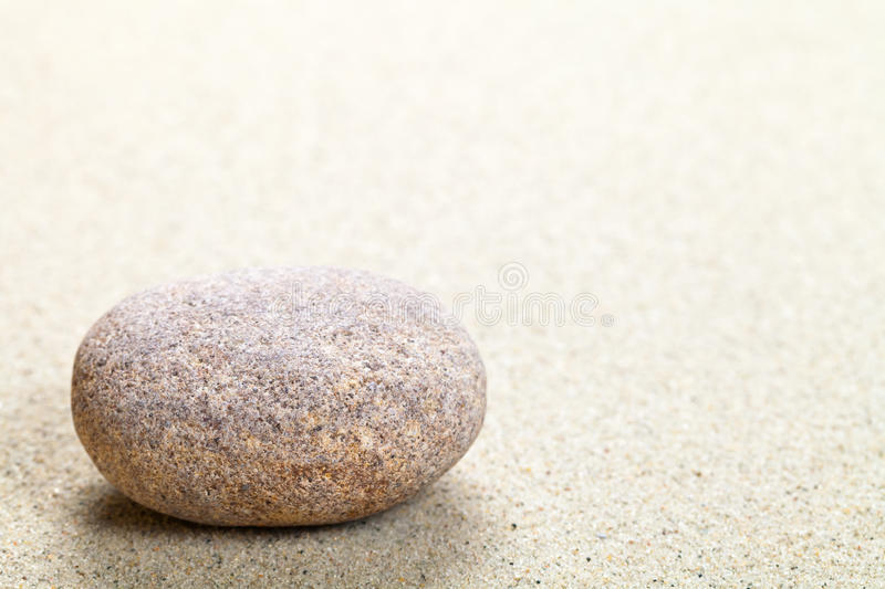 Stone. Beige stone in sand. Nature background with copy space. Macro shot stock photo