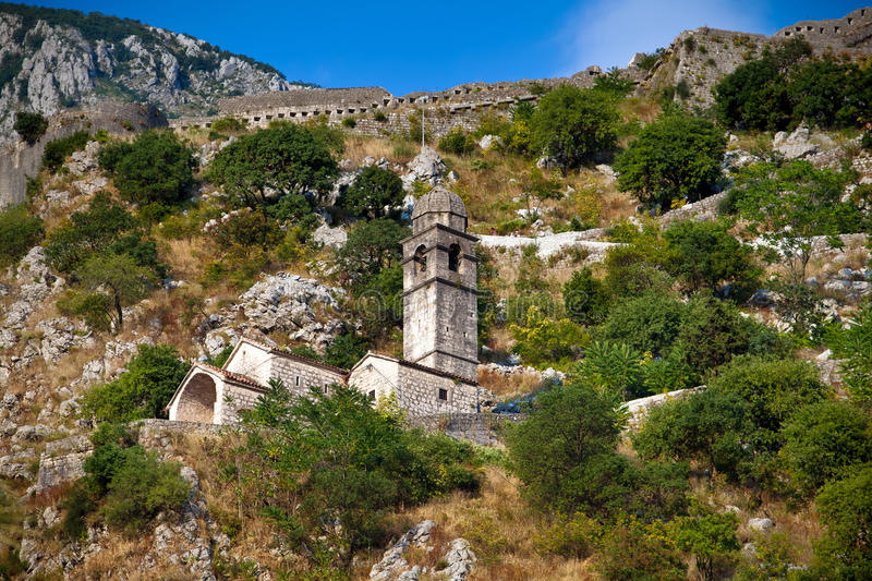 Stone bell tower of Chapel in Kotor royalty free stock photos