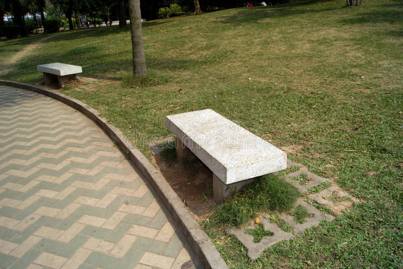 Stone benches in park stock photos