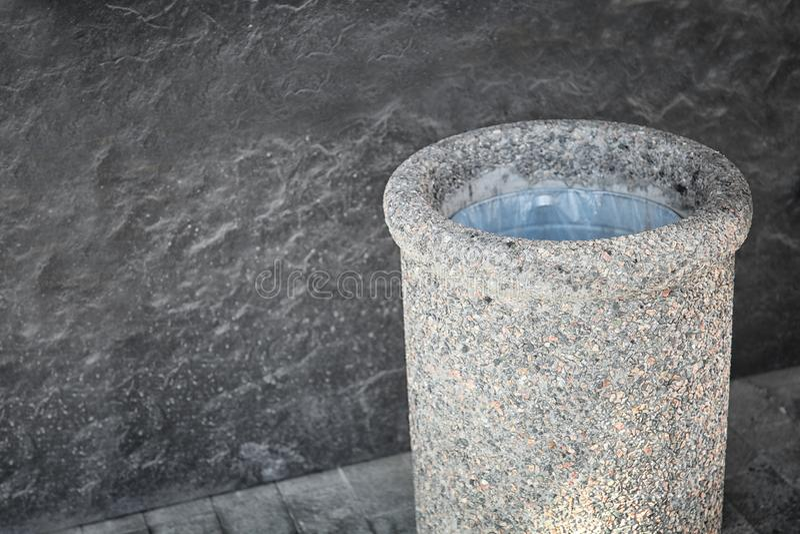 Stone bin on street. Close up royalty free stock photography