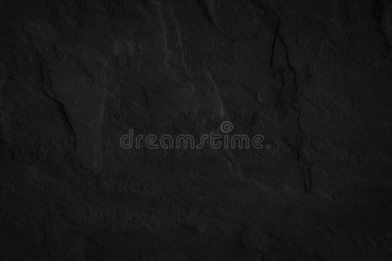 Stone black background texture. Blank for design.  royalty free stock photography